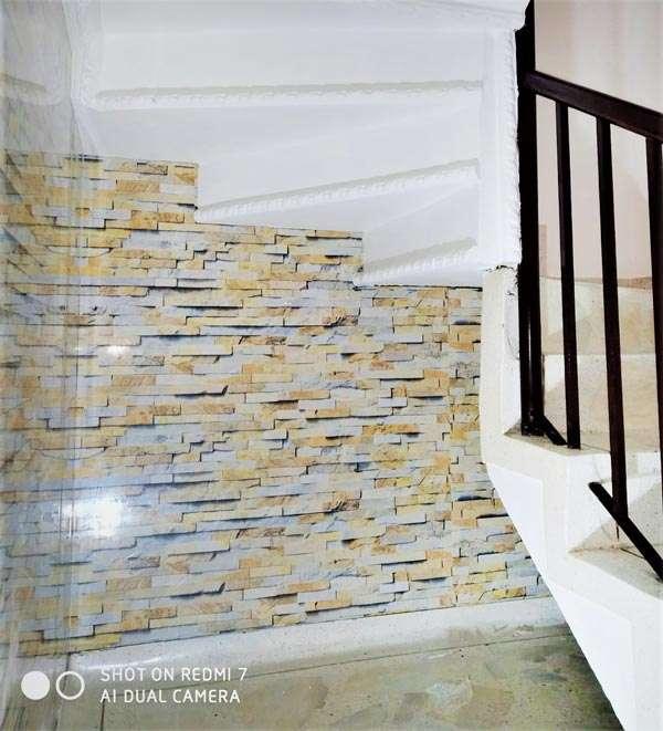 pared marmolizad en pvc travertino esalera